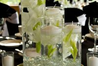 Varying Heights Of Cylinder Vases With Floating Flowers throughout sizing 3456 X 5184